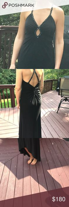 Long black Faviana homecoming dress Worn once.  Beads around straps.  92% polyester 8% spandex, very comfortable! Built in cups Faviana Dresses Prom