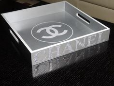"These amazing and elegant trays will STAND OUT and add the elegant touch you need at a fraction of the cost . These are not authentic Chanel trays. They are made as a tribute to ""Chanel"" and they are"