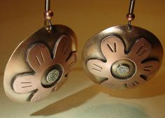 Lily disc earrings in a fusion of bronze copper and by NiciLaskin, $75.00