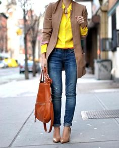 Shop this look for $209:  http://lookastic.com/women/looks/dress-shirt-and-jeans-and-shopper-handbag-and-heels-and-overcoat-and-statement-necklace/925  — Yellow Dress Shirt  — Blue Jeans  — Tobacco Leather Tote Bag  — Beige Leather Pumps  — Camel Coat  — Gold Statement Necklace