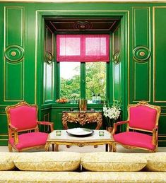 Love it, might be too much for me though but the emerald and gold walls with hot pink accents brings a fun sense of modernity to the historical room.