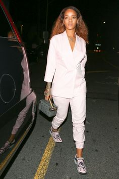 Rihanna in a pastel gingham suit, Dior sneakers, and a gray MCM handbag.