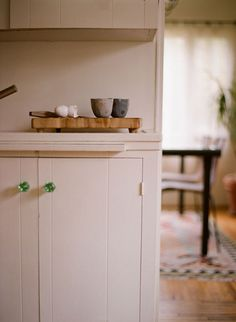 simple cupboards painted white