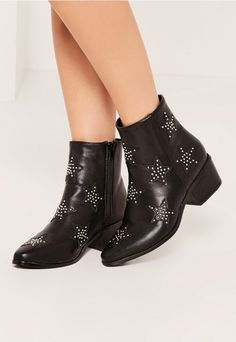 Go for a cosmic spin in these black ankle boots with star studded deets.