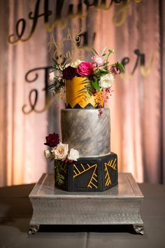 Totally unique take on the wedding cake: http://www.stylemepretty.com/little-black-book-blog/2016/04/12/the-prettiest-harry-potter-inspired-wedding-weve-ever-seen/ | Photography: Chris Isham - http://chrisishamphotography.com/