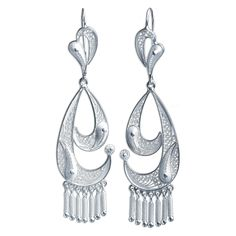 NOVICA .925 Sterling Silver Chandelier Earrings 'Waves'. An original NOVICA fair trade product in association with National Geographic. Includes an official NOVICA Story Card certifying quality & authenticity. NOVICA works with Alfredo Inga to craft this item. Includes an original NOVICA jewelry pouch to keep for yourself or give as a gift. A keepsake treasure designed to be loved for years to come.