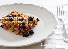 Skinny Baked Oatmeal with Blueberries and Bananas  Servings: 6 • Serving Size: 1/6th • Old Points: 4 pts • Points+: 6 pts    Calories: 211.7 • Fat: 5.4 g • Protein: 5.6 g • Carb: 38.1 g • Fiber: 3.8 g • Sugar: 22.8 g  Sodium: 76.9 mg (without salt)