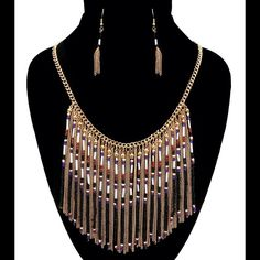 Gold chain and beaded waterfall necklace set. 18 inches and beaded fringe and gold chain fringe. This comes with matching earrings. NWT Boutique Jewelry Necklaces