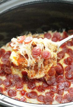 This Ultimate Pizza Dip is loaded with cheese, pepperoni and sausage and is made for the slow cooker so it stays warm and easy to dip throughout a party.