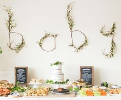 A boho baby shower event created using earthy tones . Featuring a 'baby' sign made out of twigs and natural floristry work, this post is not one to miss.
