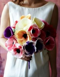 Looking for a colorful bouquet idea? This bunch of different colored anemone flowers  strikes the perfect chord. How about this idea for a Disney Pixar's UP themed wedding?