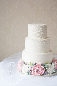 Gorgeous pink peony and rose wedding cake by Juniper Cakery