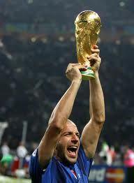 Del Piero raises the cup.