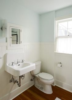 After the painting and the putting back together of everything, the bathroom does look much better. We used Benjamin Moore paint (Cottonball for the trim and Icing on the Cake for the blue walls).