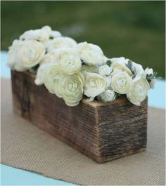 Wooden crates as centre pieces also work well at shabby chic themed weddings. This minimal design would look perfect as wedding piece.