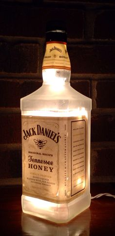 https://www.etsy.com/listing/214872709/jack-daniels-tennesse-honey-frosted see more at http://www.lightitupcreations.blogspot.com/?m=1 #bottle #seasonal #whiskey #frosted #lighted #lamp #bar #jackdaniels #honey