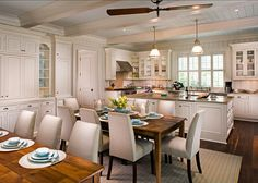 small cottage with turquoise interiors kitchen cabinet paint color sherwin williams creamy pendants are the restoration hardware keynes prism single - Sherwin Williams Kitchen Cabinet Paint