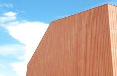 Terracotta tiles split in half to clad this artist's studio by Studio Zero85