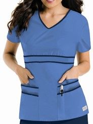 "Urbane 9569 contrast v-neck tunic scrub top features a contrast v-neck with shaped contrast banded empire waistline and six pockets with two pen divisions. Approximate center back length for size medium is 26 7/8"". Fabric is 65/35 poly/cotton except Harbor Blue/Papaya which is 60/40 cotton/poly."
