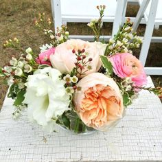 A distressed table and petite bouquet welcome guests as they find their seat for a rustic chic wedding at the Historic Barns of Nipmoose. Our Two Hearts, Blooms for Rooms