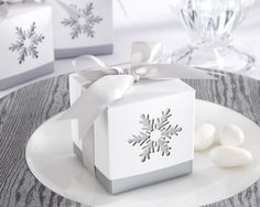 "These elegant ""Winter Dreams"" laser-cut snowflake favor boxes are a lovely way for the winter bride to package wedding favors for her guests. The silver grey bottom box shows through the white slip-on top to showcase the laser cut snowflake. Winter Wedding Favors, Wedding Favor Boxes, Unique Wedding Favors, Favour Boxes, Gift Boxes, Wedding Ideas, Favor Bags, Wedding Decor, Winter Weddings"