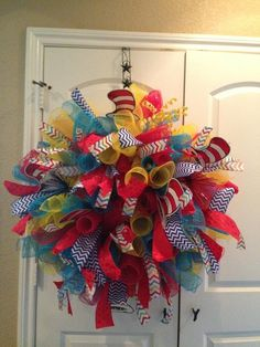 How to create a deco mesh spiral wreath with friends. It doesn't take ... a couple of materials, snacks, good friends to laugh with along the way, and plenty for the kiddos to do while you work and laugh. A great babysitter like Jules is always.