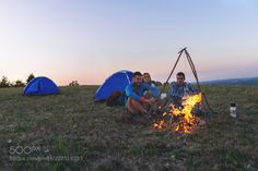 Friends Camping  around Campfire by Igor-Milic