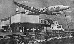 Lockheed Constellation L-1049G mounted on top of the Oasis American gas station and gift shop on Tamiami Trail about half-way between Miami and Naples, Florida in the 1970s. ~n~3