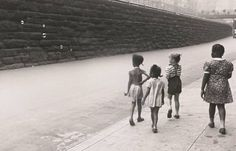 N.Y. (A group of children looking at bubbles), 1945, by Helen Levitt, The Museum of Contemporary Art, Los Angeles The Ralph M. Parsons Foundation Photography Collection