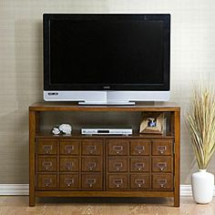 Apothecary-style media stand combines the appeal of a classic cabinet with modern practicalityFurniture features mahogany finish and antique bronze hardwareEntertainment center accommodates flat-panel TVs up to a 42 inches