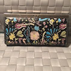 Wallet with fun design Normal wear and tear. Good condition. Bags Wallets