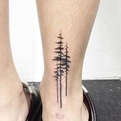Pine trees on the right Achilles heel. Tattoo artist: Hongdam