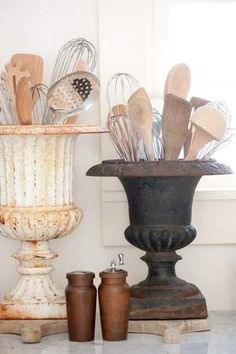 Why not re-purpose some old vases or plant pots to store your utensils?