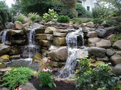 Backyard Waterfall. I want this! And we have a hill that this would be great on!