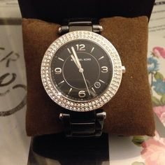 REDUCED FROM 250! Michael Kors Black Watch Selling this beautiful Michael Kors watch. There's no scratches on the links or the front of the watch. It does not come with extra links but it comes with original box. Battery needs to be replaced. PayPal will be considered. Michael Kors Jewelry