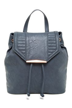 Quilted grey backpack for busy days.