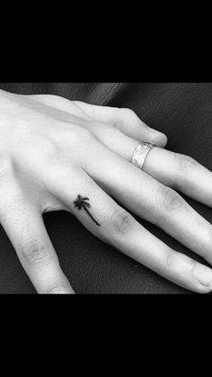 Palm tree finger tattoo