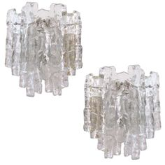 Pair of Clear Icy Glass Kalmar Sconces   From a unique collection of antique and modern wall lights and sconces at https://www.1stdibs.com/furniture/lighting/sconces-wall-lights/