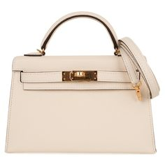 Guaranteed authentic Hermes Kelly 20 Mini Sellier bag featured in neutral perfection, Nata. Espomleather accentuated... Hermes Kelly Bag, Hermes Bags, Luxury Purses, Classic Handbags, Leather Box, Bag Sale, Mini Bag, Purses And Handbags, Totes
