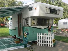 I just love this!  Cozy camping at it's best and Vintage Shasta all the way.. love the paint colors. check out those wings!