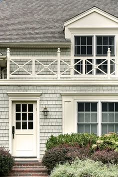 Shingle-style home, mudroom door, wood balcony railing. Exterior Paint Colors, Exterior House Colors, Exterior Design, Interior And Exterior, Gray Exterior, Gray Siding, Colonial Exterior, Beautiful Architecture, Architecture Details