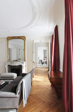 Luxuriate in the Living Room. #Marsala silk draperies. 10 Sophisticated Interiors with White Walls and Parquet Floors