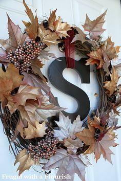 Spraypaint, grapevine wreath, floral picks/leaves and chipboard letter = Lovely!