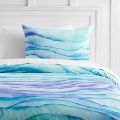 Chill out in this watercolor-like bedding that's reminiscent of sand art. | 28 Bedding Sets That Are Almost Too Cool To Sleep On