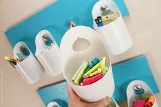 Hanging storage bins from upcycled shampoo bottles.
