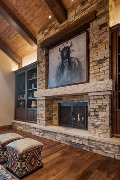 So dramatic. Would want large, flat screen TV instead of artwork. Maybe wood mantle instead of stone. Not sure about built-ins. Gas fireplace instead of wood. Love the floor too! fireplace, Mountain View From On Top — CAMEO HOMES Cabin Fireplace, Fireplace Built Ins, Fireplace Remodel, Living Room With Fireplace, Fireplace Design, Fireplace Ideas, Fireplace Stone, Stone Mantle, Fireplace Makeovers