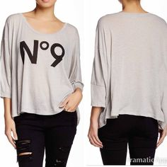 "Wildfox Top This is a NWT Wildfox 3/4 length, dolman sleeve top. Features a scoop neck, front print text and approx. length is 22"". Made in the USA. ⚜Please see my ""reasonable offers"" listing at the top of my page before submitting an offer⚜ Thank you😊 Wildfox Tops"