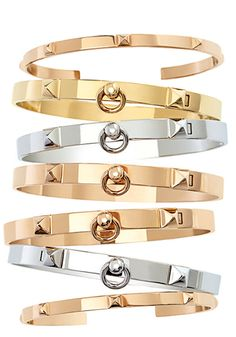 Hermes bracelets.  Nothing chicer than a stack of metal bangles.