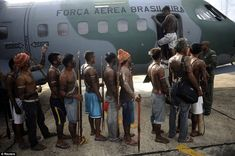 Amazonians: Munduruku Indians, many of whom are flying for the first time, board a Brazilian Air Force plane to fly to Brasilia, Brazil, for talks with the government, in Altamira, June 4