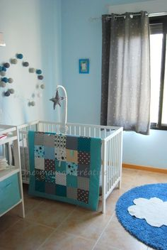 Simplicity - Cot with mat and change table. Walls and curtains are ...